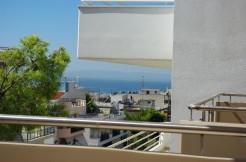 Купить в квартиру в новом доме в Афинах.