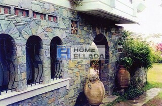 buy house in Vouliagmeni Greece
